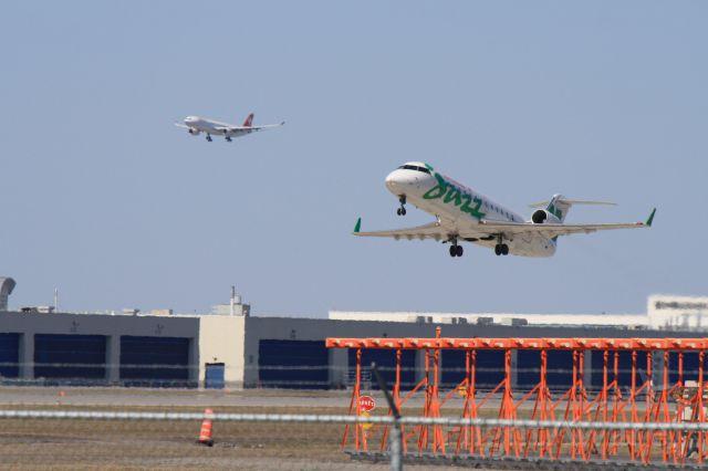 Canadair Regional Jet CRJ-200 (C-FXMY) - Swiss flight arriving and Jazz flight departing at Montreal-Trudeau