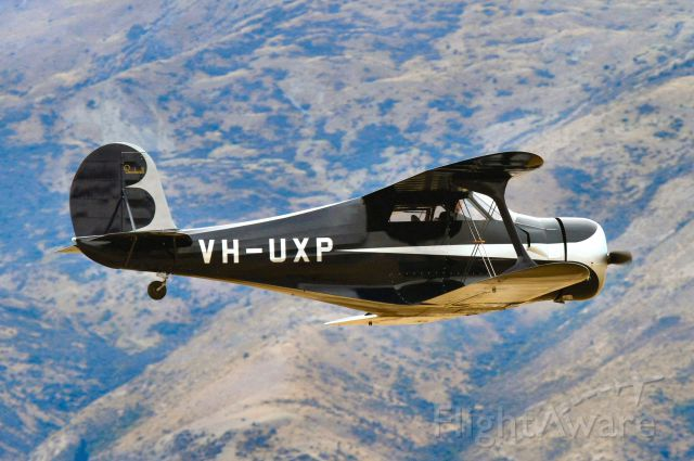 VH-UXP — - Recently restored doing fast fly past at Wanaka show Easter 2014