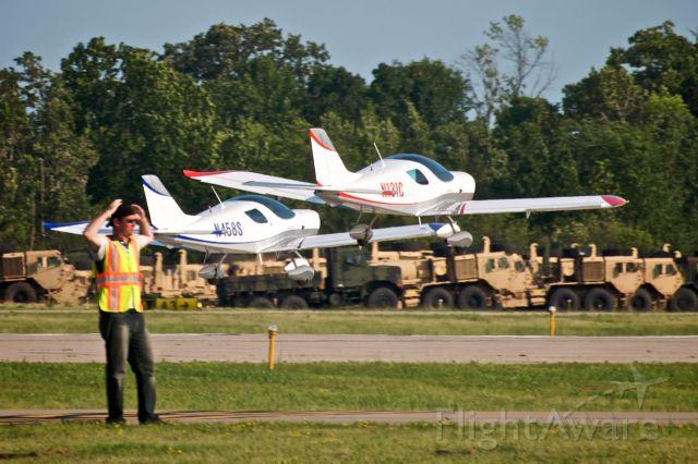 Experimental 100kts-200kts (N131C) - Twins taking off on the last day of Oshkosh EAA AirVenture 2009