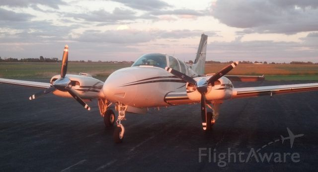 Beechcraft 55 Baron (N1832W) - Sunset at Allen County Airport, Lima, OH. Yes, that is a TKS system on the leading edge!
