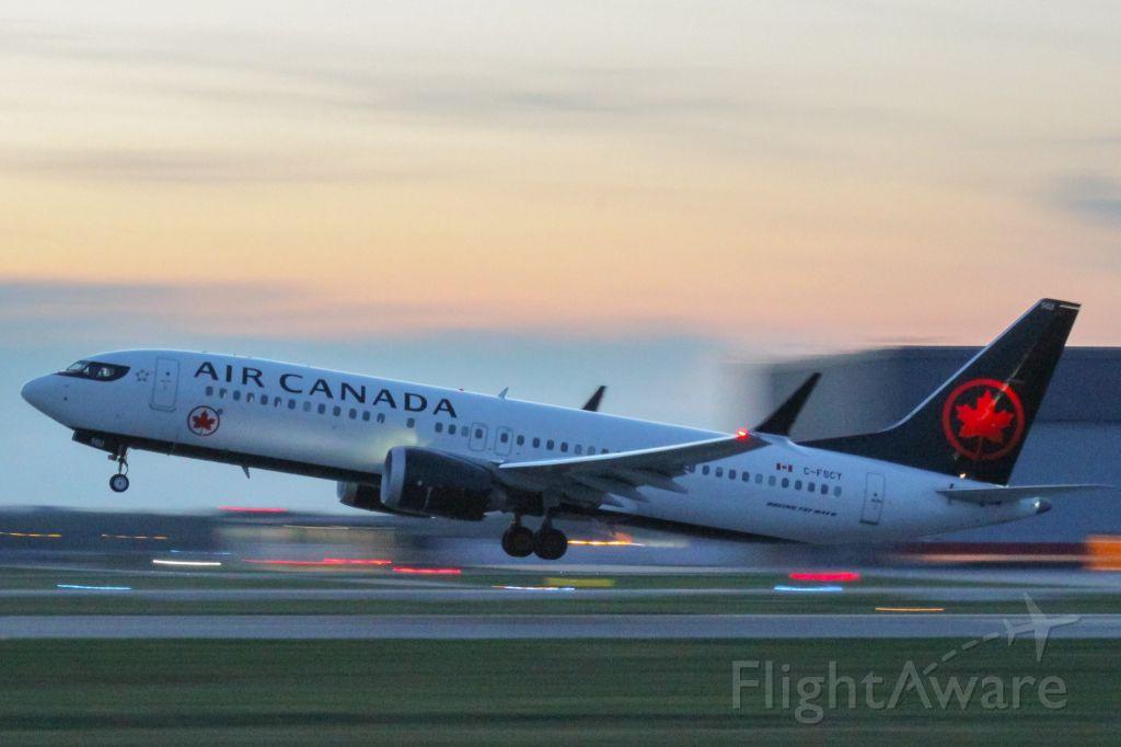Boeing 737 MAX 8 (C-FSCY) - An Air Canada 737 MAX 8 leaving YUL.