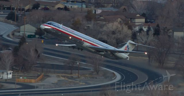"""McDonnell Douglas MD-82 (N7519A) - This early dawn takeoff of AAs N7519A captured from Rattlesnake Mountain while it was on the climb away from Reno Tahoe Internationals runway 16R was snapped a couple of years ago.  It was exactly one year ago today, February 9, 2014, that this old Mad Dog was wfu and retired into storage.  I understand the """"whys,"""" but I always enjoyed the thunder from these old birds and Im going to miss them."""