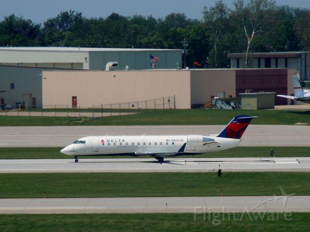 Canadair Regional Jet CRJ-200 (N8964E) - Cleared for takeoff on runway 23