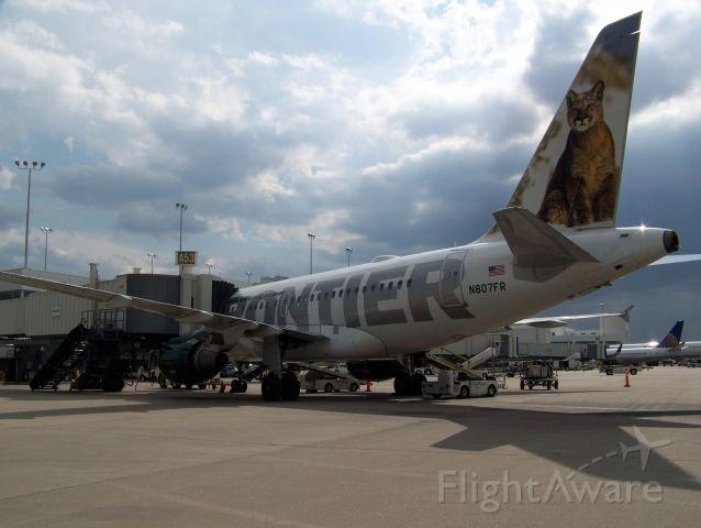 Airbus A318 (N807FR) - At A52 A Concourse DIA awaiting departure...