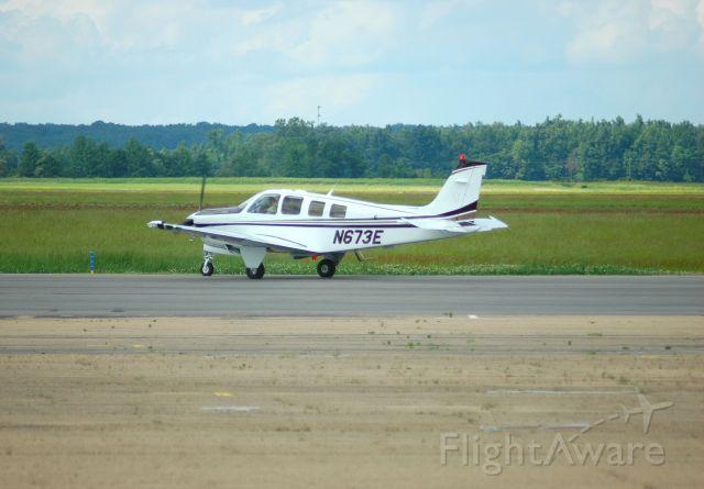 N673E — - A bonanza doing a pre-flight