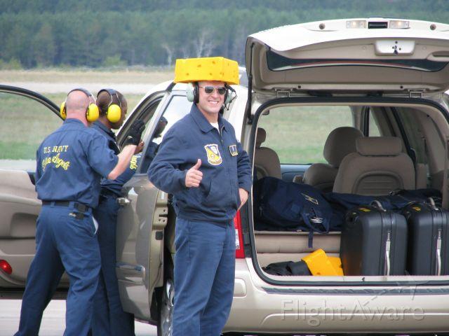— — - Blue Angel crew member in cheese head during keau airshow. Go Packers!!!