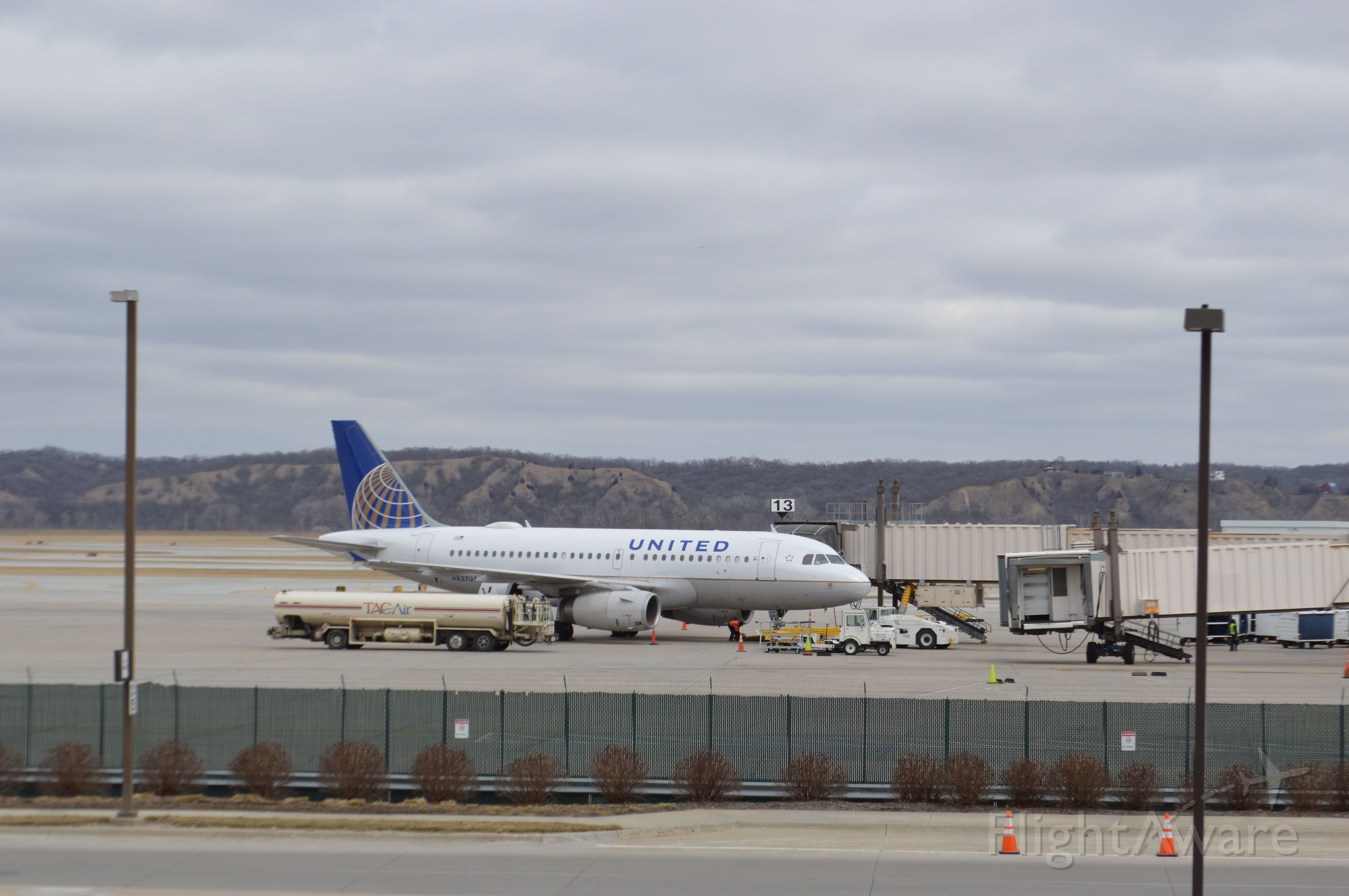 Airbus A319 (N837UA) - United 377 arrived from Denver at 12:29 P.M.  Taken March 1, 2016 with a Nikon D3200 with 18-55mm VR2 lens.