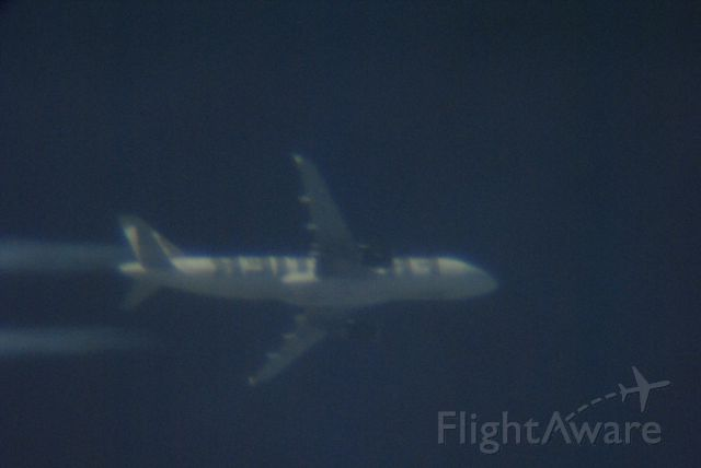 Airbus A320 (N206FR) - Taken through a telescope so the titles are backwards. Aircraft is at 32,000 ft