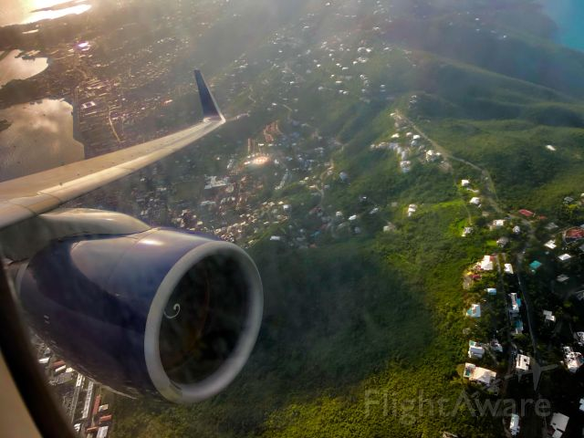 Boeing 757-200 (N690DL) - Rocketing out over St. Thomas as the sun sets on the Caribbean on DL661 to ATL.
