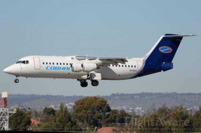 Avro RJ-100 Avroliner (VH-NJH) - On short finals for runway 05. Tuesday 22nd July 2014.