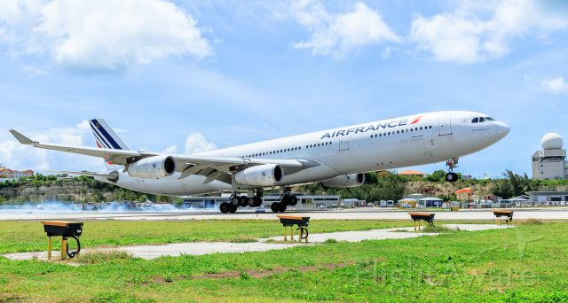 Airbus A340-200 (F-GLZJ) - Airfrance A340 landing at TNCM St Maarten.