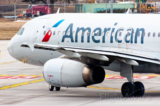 Airbus A320 (N661AW) - An American Airlines A320-200 turning onto runway 31 for a departure out to Phoenix on a windy Sunday. Shot on a Canon EOS 50D @ 400mm, 1/125th, F/8, ISO 200.
