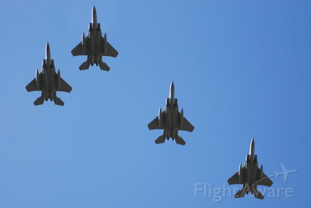 — — - A flight of four F-15s from the Oregon ANG flying over the USAFA for family weekend 2009.
