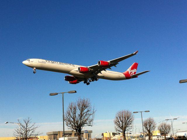 Airbus A340-600 (G-VRED) - Touchdown on Runway 09R/27L London Heathrow