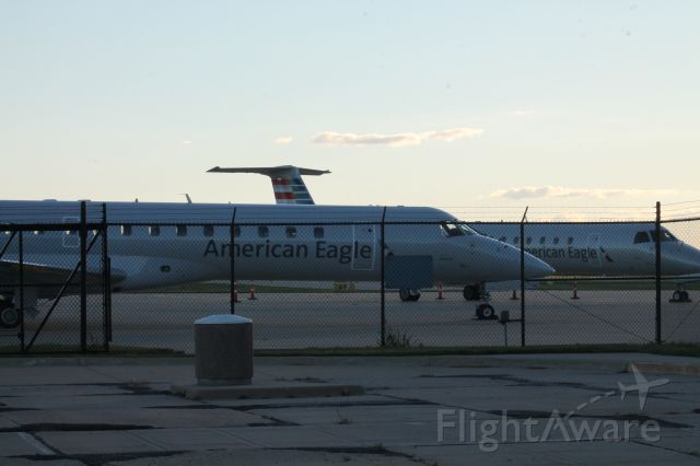 Embraer ERJ-145 (N682AE) - N682AE & N645AE sitting on the ramp at Willard Airport before heading out to DFW in a few days! N682AE was here for a few days! There were three E145