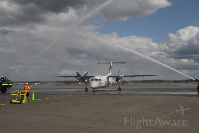 """N887EA — - Unveiling of new """"University aircraft"""" at Fairbanks airport One side UAF Nanooks, other side UAA Seawolves"""