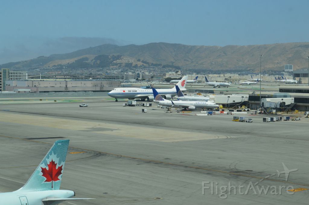 BOEING 747-8 — - A number of noontime planes at SFO as Air China 747-8 from Beijing taxies to gate.