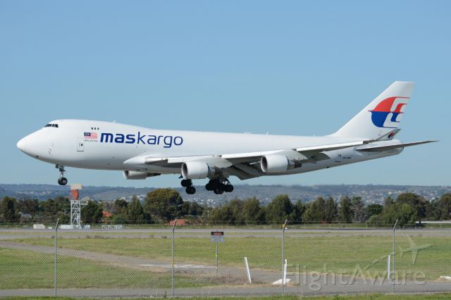 Boeing 747-200 (9M-MPR) - About to put down on runway 05. An irregular visitor to Adelaide. Wednesday, 21st May 2014.