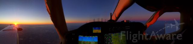 Socata TBM-850 (N889PA) - KDTN to KOJC in 2/14//14  - Valentines Day.  Sun setting over left wing.  moon rising over right wing.   iPhone 5 Panorama.
