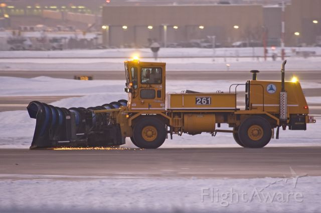 — — - Plowing the taxiway at KMSP