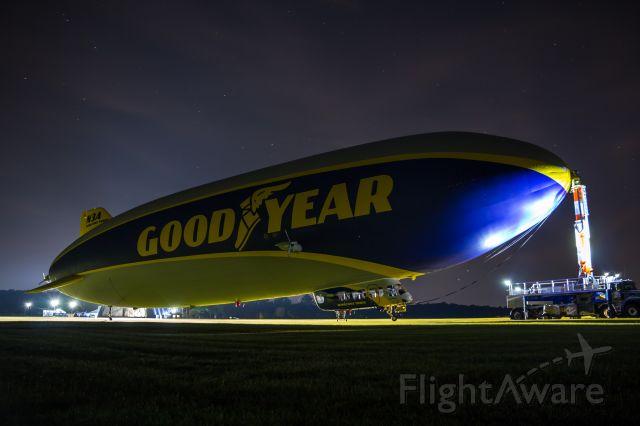 "Unknown/Generic Airship (N3A) - N3A ""Wingfoot Three"" backlit by the hangar lights at Goodyear's Wingfoot Lake Airship Base, near Akron, Ohio."