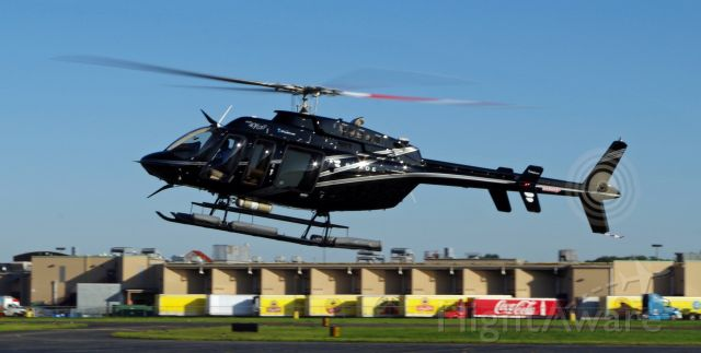 Bell 407 (N403TD) - LINDEN, NEW JERSEY, USA-SEPTEMBER 03, 2019: Seen at Linden Airport preparing to land and refuel was this commercial Bell helicopter operated for the Blade company.