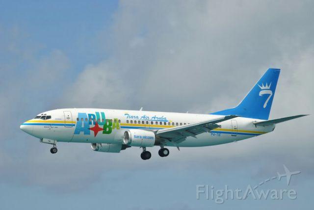 Boeing 737-700 (P4-TIE) - Awesome shot, Tiara Air 1st B733 landing in Aruba