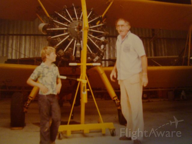 Boeing PT-17 Kaydet — - Pete and I at Multi Aero standing in front of Stearman crop duster.  Houma La.