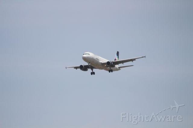 Airbus A320 (N509VL) - FINAL APPROACH 27 MMTJ