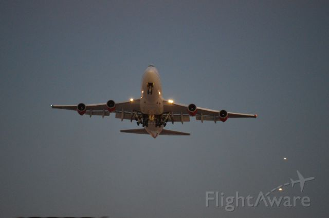 Boeing 747-400 — - Dusk departure for England.