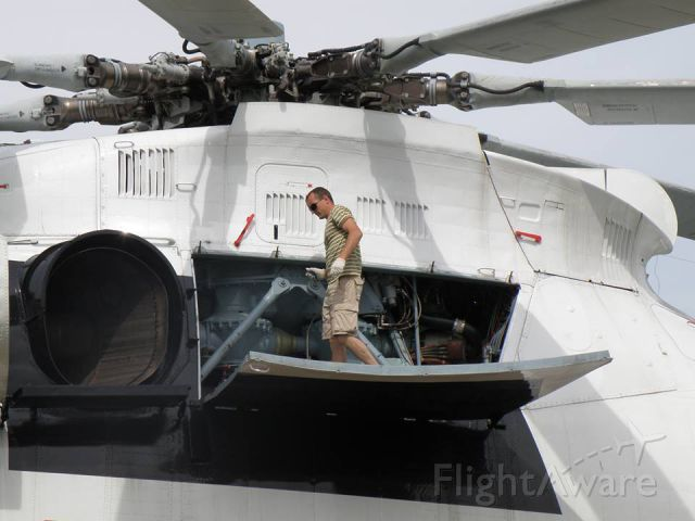 — — - Look how large a Russian Mil Mi26 helicopter is. An easy comparison with crew member standing on door during maintenance.