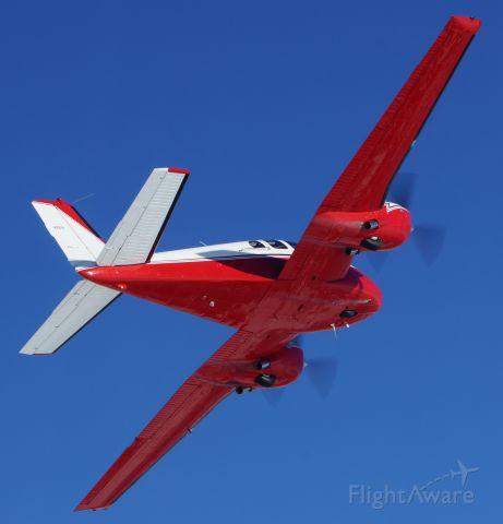 Beechcraft Twin Bonanza (N261B) - Peeling off after a photo mission.