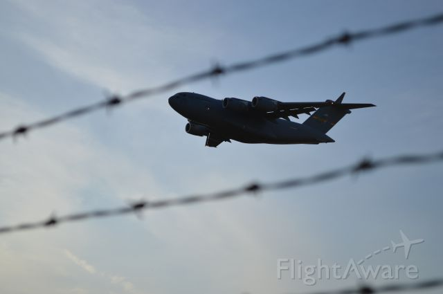 Boeing Globemaster III (N77180) - Takeoff from KLOT through barbed wire topped fence. Standing at the end of runway 20.