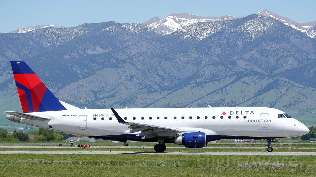 Embraer 175 (N614CZ) - Early summer at Gallatin Field, Bridgers in background