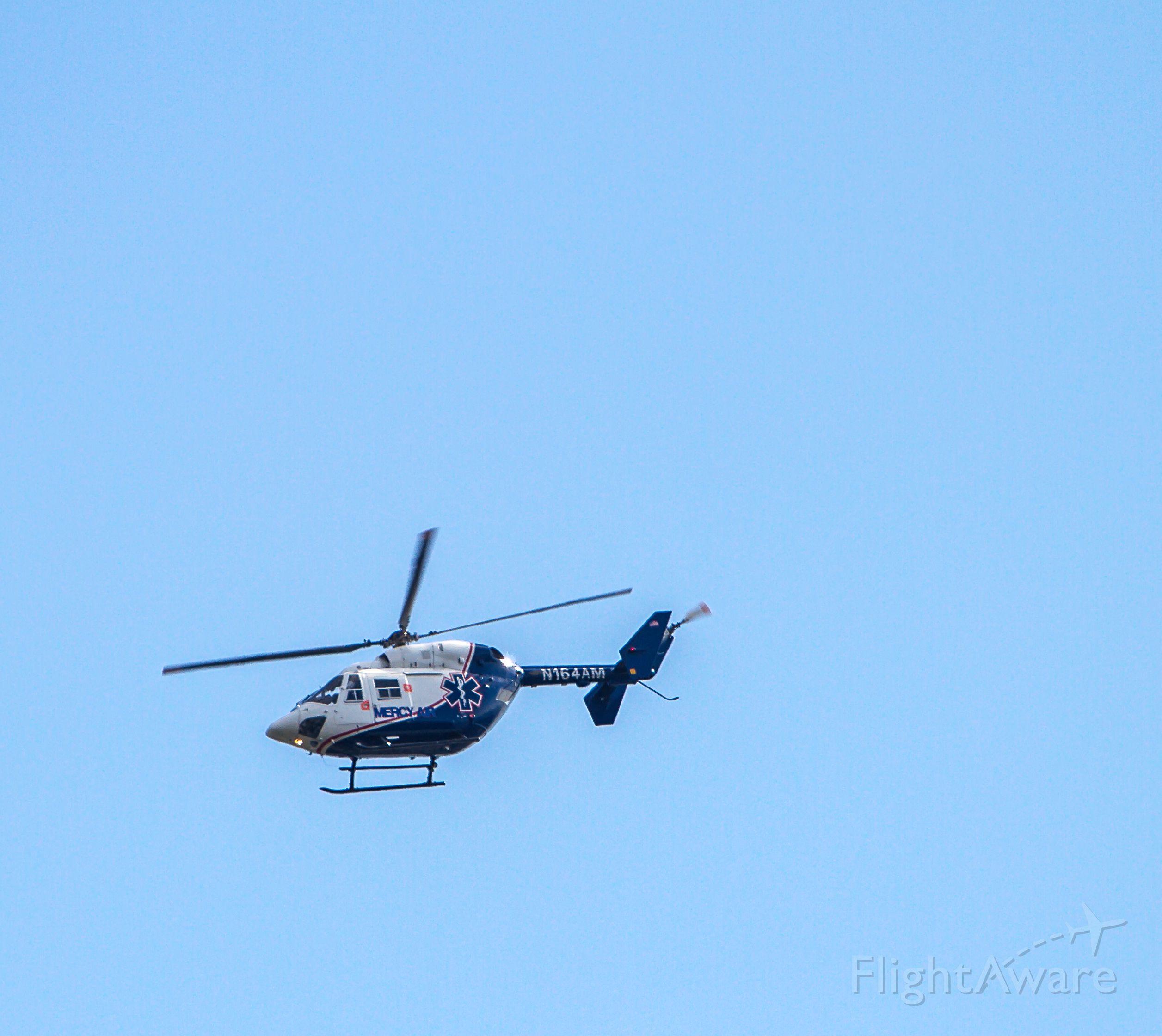 NUSANTARA NBK-117 (N164AM) - Mercy Air eastbound over the LA River near Long Beach....4-12-14