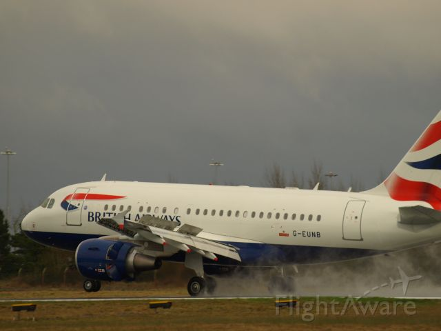 Airbus A318 (G-EUNB) - Full reverse thrust on landing on rwy 06 on a wet spring day