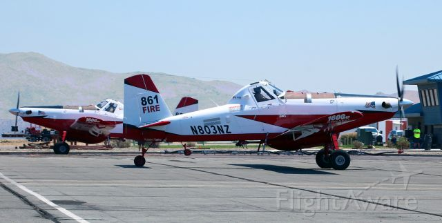 AIR TRACTOR Fire Boss (N803NZ) - A pair of CO Fire Aviation's SEAT (Single Engine Air Tanker) aircraft, N803NZ and N809NZ, are viewed here taxiing up to the air tanker base at RTS to take on another load of retardant.