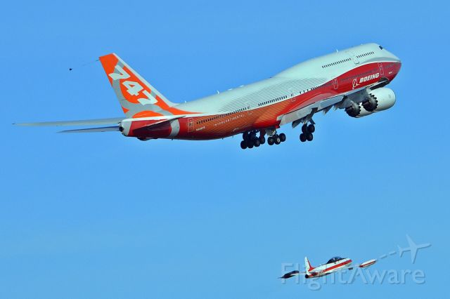 BOEING 747-8 (N6067E) - First flight with the Boeing chase plane close in trail.
