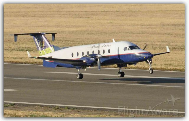 Beechcraft 1900 (N154GL) - Departing runway three-zero, Merced Regional Airport (KMCE)
