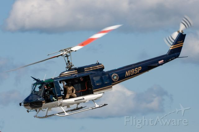 Bell UH-1V Iroquois (N19SP) - New York State Police Bell UH-1H Hueypasses the crowd during the 2019 New York Airshow. The NYSP Special Operations Response Team (SORT) used this helo as a fast-rope deployment platform for a demo during the show.