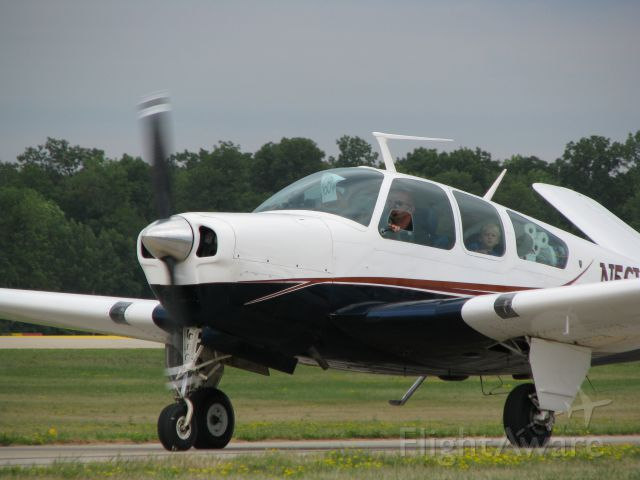 Beechcraft 35 Bonanza (N56VT) - Excited to arrive at Oshkosh.