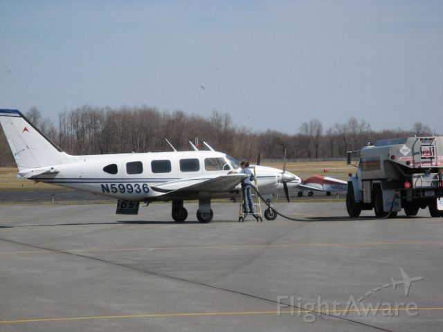 Piper Navajo (N59936) - Piper Navajo being refueled at Oswego County Airport after a flight from KCXY (Harrisburg, PA) on 4/2/09.