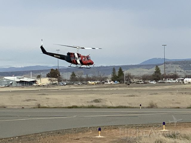 Bell UH-1V Iroquois (N633SC) - Just watching them practice.