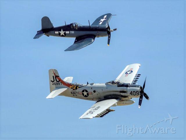 Douglas AD Skyraider (N409Z) - Douglas AD-4N Skyraider, buno 126997br /below Vought F4U-1A Corsair N83782 buno 17799. May 04 2019 at the Planes of Fame Airshow