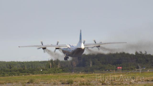 Antonov An-12 (UR-CAH) - A very smoky Antonov An-12BK takes off from CYQX.
