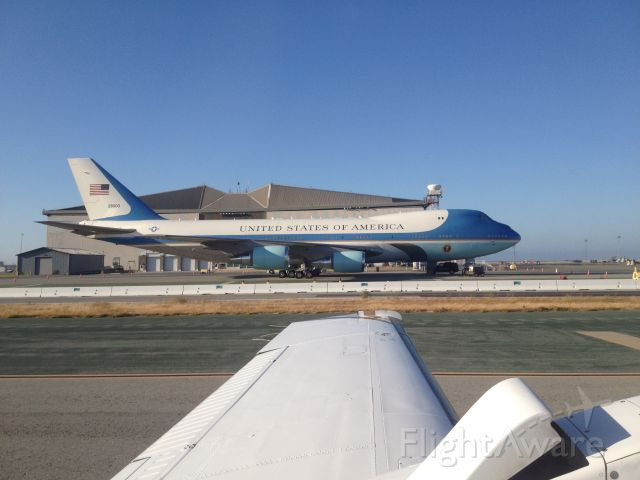 Boeing 747-200 (N28000) - As my sister taxied past the iconic aircraft while in San Francisco in July 24, 2012. Notice the Jersey barriers protecting the plane.
