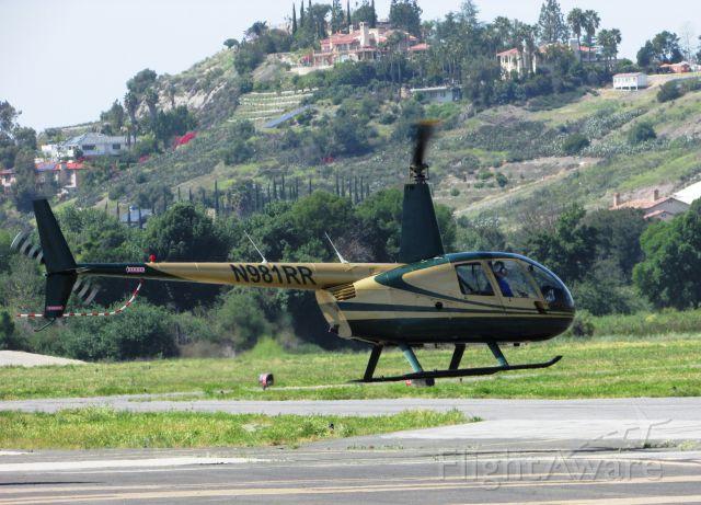 Robinson R-44 (N981RR) - Lifting off from Brackett Field