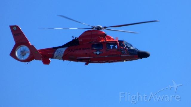 Aerospatiale Dauphin 2 (SA-365C) — - Making a low pass is this Aerospatiale HH-65 Dauphin Rotorcraft out of the base in Atlantic City New Jersey in the Spring of 2019. The Registration Number is 6571.