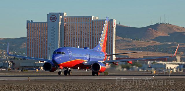 Boeing 737-700 (N7815L) - In this capture taken just at the instant that the nose wheel comes off Reno Tahoe International