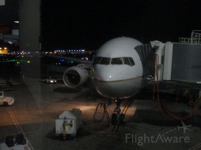 Boeing 777-200 — - Flying back home.